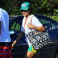 Brooke Burke et son mari David Charvet passent la journée à la plage à Malibu, le 10 août 2014.