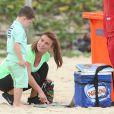 """""""Coleen Rooney avec son fils Kai sur la plage d'Ipanema à Rio, le 20 juin 2014"""""""