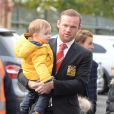 MANCHESTER, UNITED KINGDOM - OCTOBER 05: Wayne Rooney arrives at Old Trafford with wife Coleen Rooney and kids to watch Everton's match with Man United on October 05, 2014 in Manchester, England. Rooneys is sidelined for 3 games after being sent off last week. PHOTOGRAPH BY Paul Cousans / Barcroft Media UK Office, London. T +44 845 370 2233 W www.barcroftmedia.com USA Office, New York City. T +1 212 796 2458 W www.barcroftusa.com Indian Office, Delhi. T +91 11 4053 2429 W www.barcroftindia.com05/10/2014 - Manchester