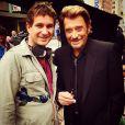 """Johnny Hallyday et le réalisateur de son clip """"Seul"""", Pierre Rambaldi, à Los Angeles le 12 octobre 2014."""
