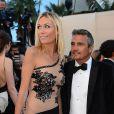 Richard Virenque avec sa charmante compagne Marie-Laure à Cannes le 23 mai 2013 lors du 66e Festival du film.  Le couple a eu le 3 octobre 2014 son premier enfant, un fils prénommé Eden.