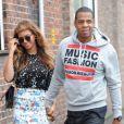 Beyoncé Knowles et son mari le rappeur Jay-Z dans les rues de Londres, le 15 octobre 2014.