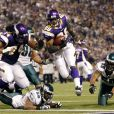 Adrian Peterson, running back des Vikings du Minnesota, file au touchdown en janvier 2009 contre les Eagles de Philadelphie.