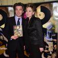 Grace de Capitani et son compagnon Jean-Pierre Jacquin au Gala de l'enfance maltraitée à la Salle Gaveau à Paris le 9 mars 2015.