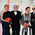 La princesse Charlene de Monaco, le prince Albert II de Monaco, la princesse Caroline de Hanovre et Karl Lagerfeld arrivant au Bal de la Rose 2014, sur le thème du constructivisme russe, au Sporting de Monte-Carlo le 29 mars 2014.
