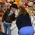 Cindy Lopes et Bruno Moneroe à la soirée d'ouverture de la Foire du Trône, organisée au profit du Secours populaire à Paris le 27 mars 2015.