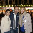 Saïda Jawad, Marc-Emmanuel Dufour et Valérie Trierweiler à la soirée d'ouverture de la Foire du Trône, organisée au profit du Secours populaire à Paris le 27 mars 2015.