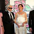 Charlotte Casiraghi, Karl Lagerfeld, Caroline de Hanovre et le prince Albert II lors du Bal de la Rose, dans la Salle des Etoiles du Sporting Monte-Carlo, le 28 mars 2015 à Monaco
