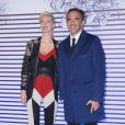 """Nikos Aliagas et sa compagne Tina Grigoriou - Photocall de la soirée de vernissage de l'exposition """"Jean Paul Gaultier"""" au Grand Palais à Paris, le 30 mars 2015."""