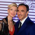 """Tina Grigoriou et Nikos Aliagas - Photocall de la soirée de vernissage de l'exposition """"Jean Paul Gaultier"""" au Grand Palais à Paris, le 30 mars 2015."""