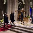 """""""Le prince Albert II, suivi de la princesse Charlene, des princesses Caroline et Stéphanie, de Pierre Casiraghi, la princesse Alexandra et Camille Gottlieb, se sont recueillis à la mémoire du prince Rainier III pour le dixième anniversaire de sa mort, lors d'une cérémonie en la cathédrale Notre-Dame-immaculée de Monaco le 7 avril 2015"""""""