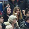 Michaël Youn accompagné d'Isabelle Funaro et son fils Sean assistent à la finale de la Coupe de la Ligue entre le PSG et le SC Bastia au Stade de France, à Saint-Denis, le 11 avril 2015.
