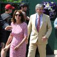 Carole et Michael Middleton arrivent au tournoi tennis de Wimbledon à Londres, le 2 juillet 2014.