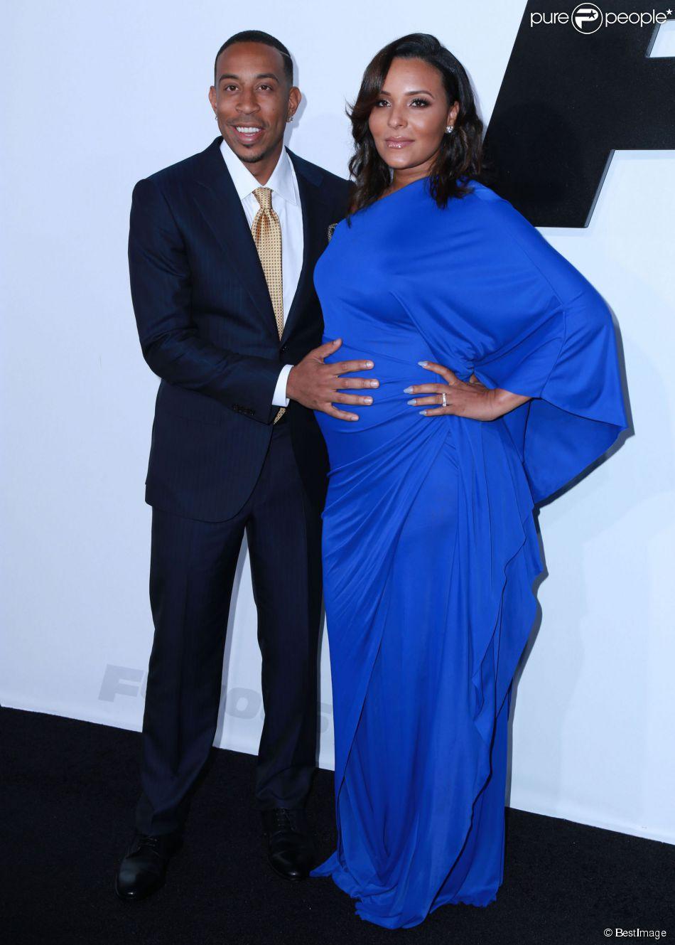 """Ludacris et sa femme Eudoxie enceinte - Avant-première du film """"Fast and Furious 7"""" à Hollywood, le 1er avril 2015."""