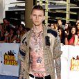 """Machine Gun Kelly - Cérémonie des """"MTV Movie Awards 2015"""" à Los Angeles, le 12 avril 2015."""