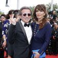 """Philippe Manoeuvre et sa femme Candice de la Richardière, in love :  Montée des marches du film """"Mad Max : Fury Road"""" lors du 68 ème Festival International du Film de Cannes, à Cannes le 14 mai 2015."""