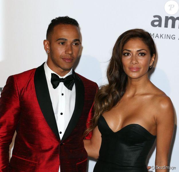 """Lewis Hamilton et sa compagne Nicole Scherzinger - Photocall de la soirée """"AmfAR's 21st Cinema Against AIDS"""" à l'Eden Roc au Cap d'Antibes lors du 67ème festival du film de Cannes, le 22 mai 2014."""