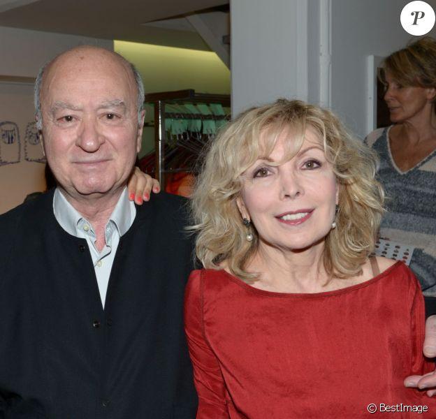 Georges Wolinski entre sa fille et sa femme - Archive - People au 25 ans de l'eau dynamisante chez Colette a Paris, le 29 mai 2012.