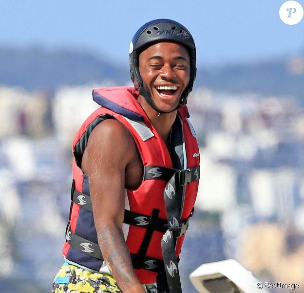 Raheem Sterling, tout sourire en vacances à Ibiza entouré de ses amis, le 20 juin 2015