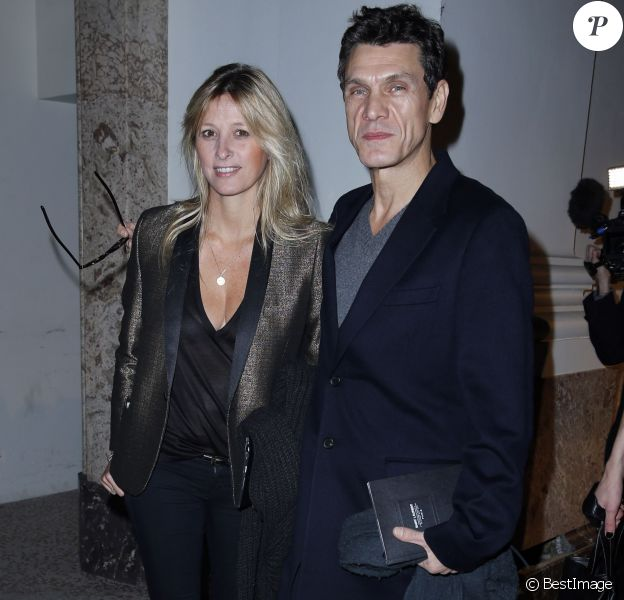 Marc Lavoine et sa femme Sarah Poniatowski Presentation de la collection Homme Yves Saint Laurent au Grand Palais, à Paris le 20 janvier 2013