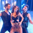 """Fabienne Carat danse avec deux partenaires, dans """" Danse avec les stars 6""""  sur TF1, le samedi 12 décembre 2015."""