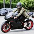 """Exclusif - Prix Spécial - Justin Bieber fait de la moto à Los Angeles, le 17 mars 2015. Le chanteur a customisé sa moto Ducati avec ses initiales """"JB"""". Escorté par ses gardes du corps, Justin a suivi la voiture de Corey Gamble (ex de Kris Jenner) vers une destination inconnue!"""