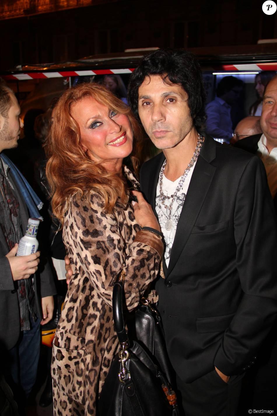 Julie Piétri et Jean-Luc Lahaye à la soirée des 50 ans de la boutique parisienne de Maurice Renoma, le 22 octobre 2013.