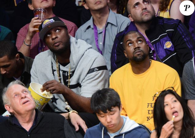 Lamar Odom et Kanye West assistent à la rencontre Los Angeles Lakers - Utah Jazz au Staples Center. Los Angeles, le 13 avril 2016.