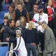 Didier Deschamps et sa femme Claude, Nagui et sa femme Mélanie Page - Les joueurs retrouvent leur famille dans les tribunes à la fin du match de quart de finale de l'UEFA Euro 2016 France-Islande au Stade de France à Saint-Denis le 3 juillet 2016. © Cyril Moreau / Bestimage
