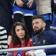 Olivier Giroud et sa compagne Jennifer - Les joueurs retrouvent leur famille dans les tribunes à la fin du match de quart de finale de l'UEFA Euro 2016 France-Islande au Stade de France à Saint-Denis le 3 juillet 2016. © Cyril Moreau / Bestimage