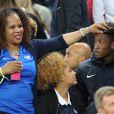 Kingsley Coman et sa compagne Sephora - Les joueurs retrouvent leur famille dans les tribunes à la fin du match de quart de finale de l'UEFA Euro 2016 France-Islande au Stade de France à Saint-Denis le 3 juillet 2016. © Cyril Moreau / Bestimage