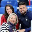 Olivier Giroud avec sa compagne Jennifer - Les joueurs retrouvent leur famille dans les tribunes à la fin du match de quart de finale de l'UEFA Euro 2016 France-Islande au Stade de France à Saint-Denis le 3 juillet 2016. © Cyril Moreau / Bestimage