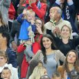 Ludivine Sagna (la femme de Bacary Sagna), Ludivine Payet (la femme de Dimitri Payet) avec son fils Milan, Tiziri Digne (La femme de Lucas Digne) lors du match du quart de finale de l'UEFA Euro 2016 France-Islande au Stade de France à Saint-Denis, France le 3 juillet 2016. © Cyril Moreau/Bestimage