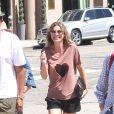 Ellen Pompeo quitte un restaurant avec son mari Chris Ivery le 13 juillet 2015.