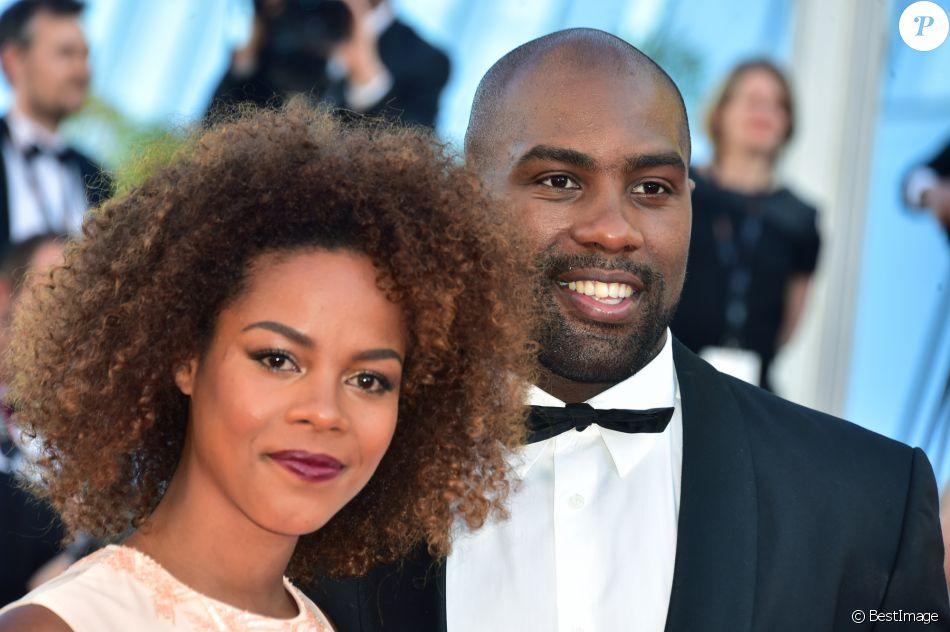 """Teddy Riner et sa compagne Luthna lors de la montée des marches du film """"Elle"""" lors du 69ème Festival International du Film de Cannes, le 21 mai 2016 à Cannes"""