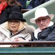 Mireille Darc et son mari Pascal Desprez - People dans les tribunes des internationaux de France de Roland Garros à Paris le 3 juin 2016. © Dominique Jacovides / Bestimage