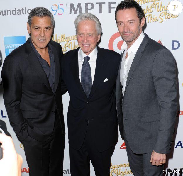 George Clooney, Michael Douglas, Hugh Jackman lors du 95e anniversaire du MPTF à Los Angeles, le 1er octobre 2016.