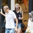 Dakota Fanning et son compagnon Jamie Strachan se promènent dans les rues de New York. Le 30 août 2015