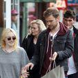 Dakota Fanning et son petit ami Jamie Strachan se promenent dans le quartier de Soho, New York, le 18 Octobre 2013.