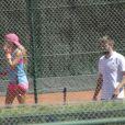 Shakira et son compagnon Gerard Piqué sortent jouer au tennis avec leurs enfants Milan et Sasha à Barcelone le 3 septembre 2016.