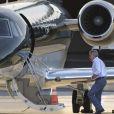 Exclusif - Harrison Ford, sa femme Calista Flockhart et leur fils Liam embarquent à bord de leur jet privé à Santa Monica, le 21 novembre 2012.