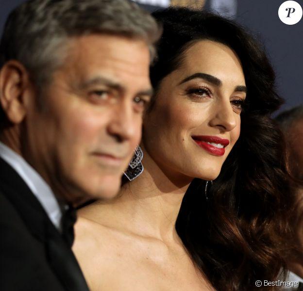 George Clooney et son épouse Amal Clooney - Photocall de la 42ème cérémonie des Cesar à la salle Pleyel à Paris, le 24 février 2017.