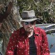 Johnny Hallyday arrive avec sa chienne Cheyenne pour aller déjeuner avec ses amis, P. Rambaldi et le musicien J.C. Sindres au restaurant Nobu dans le quartier de Malibu à Los Angeles, Californie, Etats-Unis, le 2 avril 2017