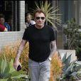 Johnny Hallyday, souriant, très en forme et très amoureux de sa femme Laeticia sort déjeuner en famille au Water Grill de Santa Monica le 18 mars 2017 pour l'anniversaire de Laeticia qui fête le jour même ses 42 ans.