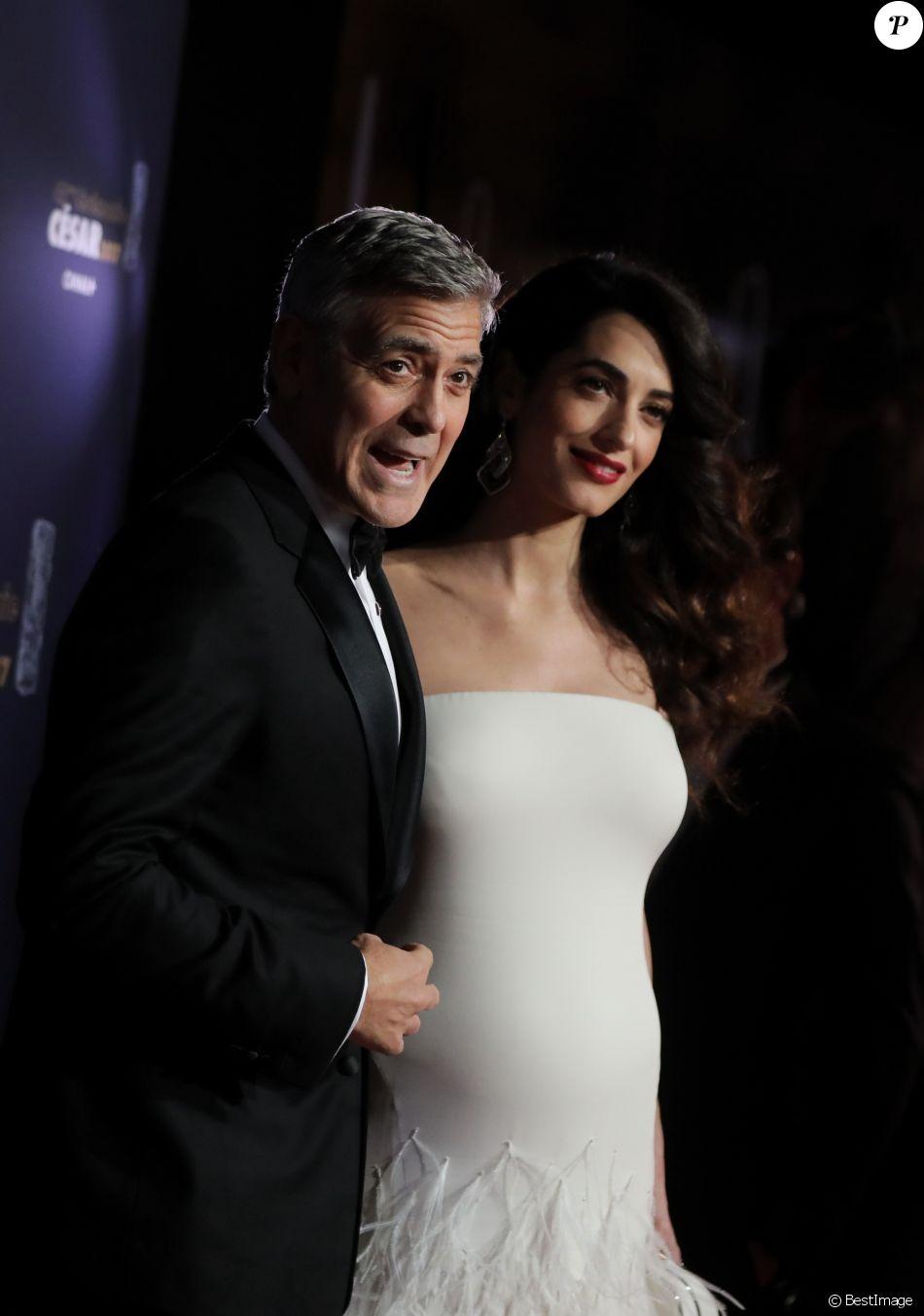 George Clooney (montre Omega) et sa femme Amal Alamuddin-Clooney (enceinte) - Photocall de la 42e cérémonie des Cesar à la salle Pleyel à Paris, le 24 février 2017. © Dominique Jacovides - Olivier Borde / Bestimage