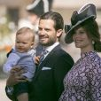 """""""Le prince Carl Philip de Suède en compagnie de sa femme Sofia enceinte et de leur fils Alexandre assistent à une messe à l'occasion du 40ème anniversaire de la princesse Victoria de Suède au palais Royal de Stockholm en Suède, le 14 juillet 2017"""""""