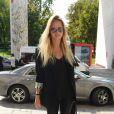 Natasha Poly arrivant au défilé Versace à la Triennale de Milan lors de la Fashion Week de Milan le 22 septembre 2017. Donatella Versace y a rendu un hommage puissant et inspiré à son défunt frère Gianni.