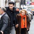 Liliane Bettencourt et son petit fils Jean-Victor Meyers quittent le restaurant du Bristol à Paris le 21 février 2013.