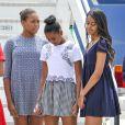 La première dame des Etats-Unis Michelle Obama, ses filles Malia et Sasha (Natasha) et sa mère Marian Robinson à leur accueil par Luigi Brugnaro et Luca Zaia lors de leur arrivée en avion à l'aéroport de Venise, le 19 juin 2015.