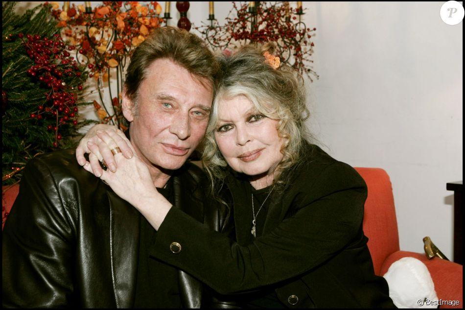 Johnny Hallyday et Brigitte Bardot lors du Noël des animaux de Levallois-Perret en 2004